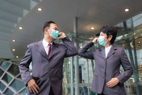 Old_asian_business_people_greeting_togather_by_new_methode_with_mask_for_prevent_covid_19,_this_image_can_use_for_covid-19,_corona_virus_and_shakehands_concept.
