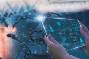 Industry_engineer_in_factory,using_smart_tablet_glass_device,control_automated_robot_arm_machine_learning_operation,concept_business_and_industry_4.0,Artificial_intelligence_or_AI,with_5G_network