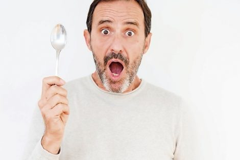 Senior_man_holding_silver_spoon_over_isolated_background_scared_in_shock_with_a_surprise_face,_afraid_and_excited_with_fear_expression