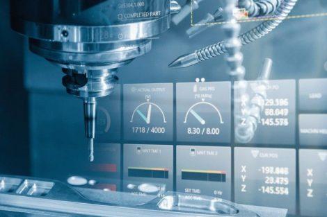 The_CNC_milling_machine_cutting_the_sample_part.The_end-mill_tool_cutting_the_mold_part_by_CNC_milling_machine.