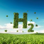 Eco_friendly_clean_hydrogen_energy_concept._3d_rendering_of_hydrogen_icon_on_fresh_spring_meadow_with_blue_sky_in_background.