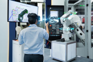 Sale_engineer_testing_virtual_reality_glasses_3D_scan_with_joystick_programming_automated_robot_industry_in_smart_factory,_Technology_4.0_concept