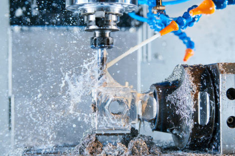 Milling_metalworking_process._Industrial_CNC_machining_of_metal_detail_by_cutting_end-tooth_vertical_mill_at_factory._Coolant