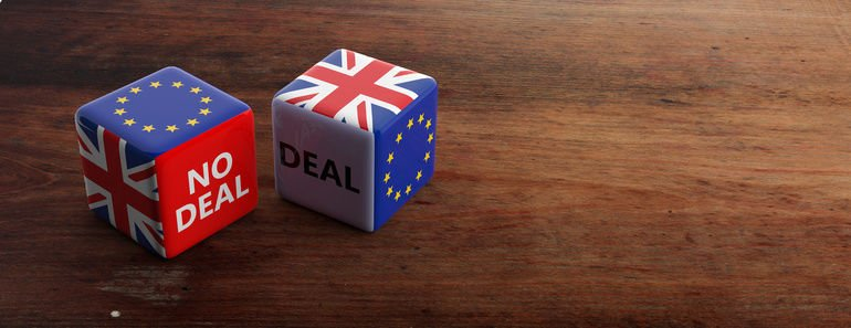 Brexit,_deal_or_no_deal_concept._United_Kingdom_and_European_Union_flags_on_dice,_wooden_background,_banner,_copy_space._3d_illustration