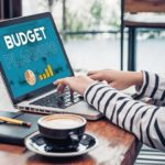 Close_up_hand_of_influencer_budget_planning_for_online_media_advertising_at_cafe_restaurant.online_marketing_concept