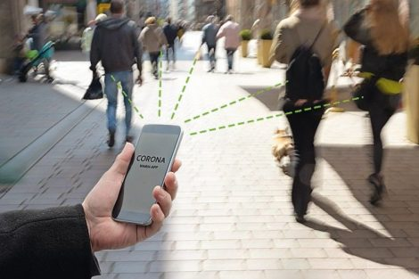 Smart_phone_with_Corona_Warn_App,_the_contact_tracking_or_tracing_application_against_Covid_19_pandemic_is_connecting_other_phones_from_moving_people_in_the_city_to_analyze_the_risk_of_infection,_copy_space,_blur_motion,_selected_focus_