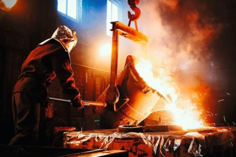 Workers_operates_at_the_metallurgical_plant._The_liquid_metal_is_poured_into_molds._Worker_controlling_metal_melting_in_furnaces.