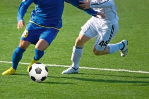 Photo_of_soccer_players_with_ball_in_action_