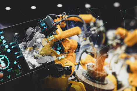 Engineer_hand_using_digital_tablet_and_checking_welding_robotics_automatic_arms_machine._Augmented_reality_in_intelligent_factory__industrial_with_monitoring_system_software.