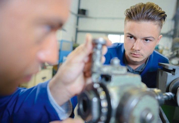 engine_assemblers_working_on_a_machine