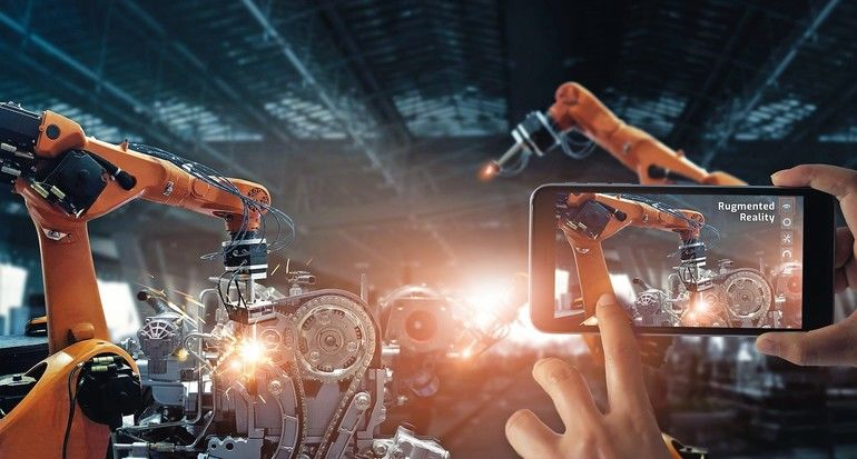 Augmented_reality_industry_concept._Hand_holding_mobile_smartphone_use_AR_application_to_check_and_control_welding_robotics_automatic_arms_machine_in_intelligent_factory_automotive_industrial_with_monitoring_system_software._Digital_manufacturing_operatio