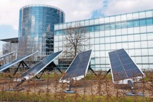 Blue_rotating_solar_panels_tilted_axis_tracker,_future_innovation_energy_concept