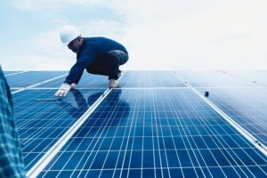 engineer_team_working_on_replacement_solar_panel_in_solar_power_plant;engineer_and_electrician_team_swapping_and_install_solar_panel_after_solar_panel_voltage_drop_
