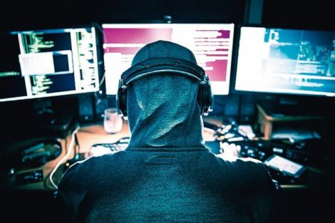Professional_Hacker_at_Work_in_Front_of_His_Tree_Displays_Hacking_Center.