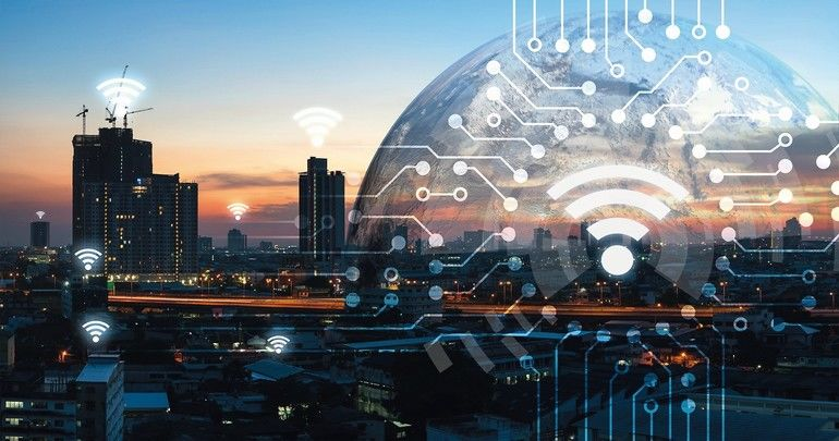 Internet_of_things_,_iot_,_smart_home_,_smart_city_and_network_connect_concept._Human_hand_holding_white_phone_and_iot_icon_with_city_sunset_view_and_earth_furnished_by_NASA._background_and_wifi_icons