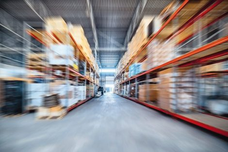 Warehouse_industrial_and_logistics_companies._Long_shelves_with_a_variety_of_boxes_and_containers._Motion_blur_effect.