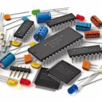 Group_of_various_electronic_components:_microprocessors,_logical_digital_microchips,_transistors,_capacitors,_resistors,_LEDs_etc._isolated_on_white_background