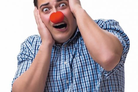 Funny_man_clown_isolated_on_white_background