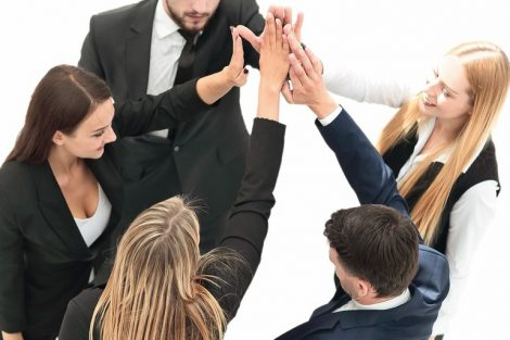 group_of_business_people_shows_his_success_,hands_clasped_together.isolated_on_white