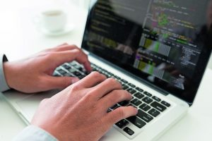 Hands_of_coder_working_on_new_application