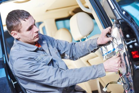 automotive_soundproof_and_noise_reduction_insulation._auto_repair_mechnic_worker_placing_the_sound_damping_mats_on_car_door_panels