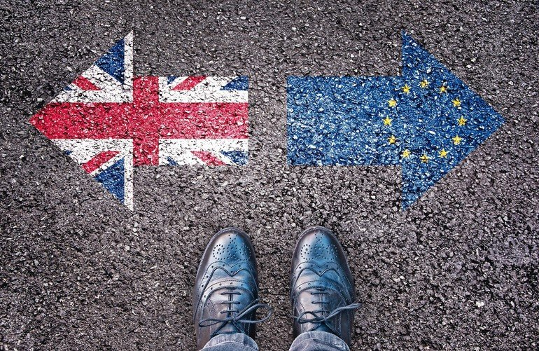 Brexit,_flags_of_the_United_Kingdom_and_the_European_Union_on_asphalt_road_with_legs