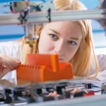 Young_woman_work_with_3d_printer