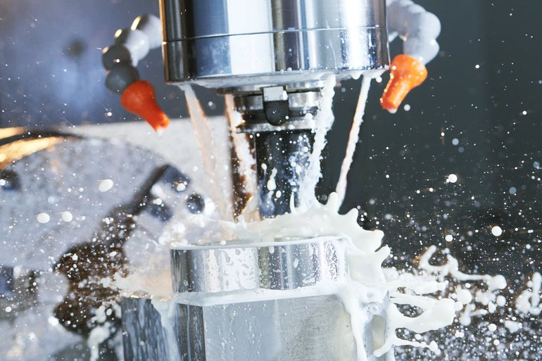 Milling_metalworking_process._Industrial_precision_CNC_metal_machining_by_vertical_cutting_mill_with_coolant