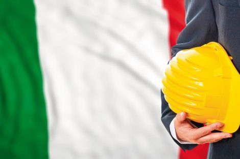 Engineer_on_a_waiving_Italy_flag_background._3d_illustration
