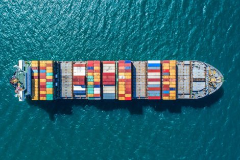 container_ship_in_import_export_and_business_logistic.By_crane_,Trade_Port_,_Shipping.cargo_to_harbor.Aerial_view.Water_transport.International.Shell_Marine.Top_view.