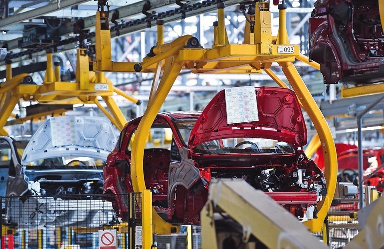 Car_bodies_on_the_production_line_inside_automobile_factory