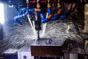 Metalworking_CNC_milling_machine._Cutting_metal_modern_processing_technology._Small_depth_of_field._Warning_-_authentic_shooting_in_challenging_conditions._A_little_bit_grain_and_maybe_blurred.