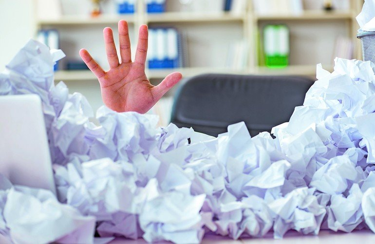 Businessman_in_paper_recycling_concept_in_office