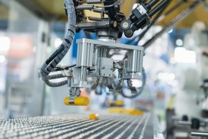 Industrial_robot_with_conveyor_in_manufacture_factory,Smart_factory_industry_4.0_concept.