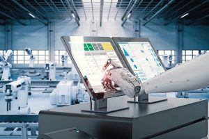 3d_rendering_robot_working_on_monitor_screen_in_factory