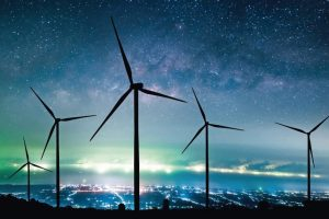 Eco_power._silhouette_Wind_turbines_generating_electricity_with_milky_way.