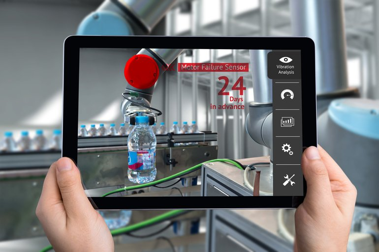 Engineer_hand_using_tablet,_automation_robot_arm_machine_in_smart_factory_with_tablet_real_time_vibration_analysis_monitoring_system_application_for_check_motor_failure._Industry_4th_sensor_concept.