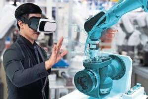 Virtual_reality_technology_in_industry_4.0._Business_man_suit_wearing_VR_glasses_to_see_AR_service_,_Thermal_Monitoring_motor_for_check_destroy_part_of_smart_robot_arm_machine_in_smart_factory.