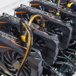 Graphics_cards_standing_in_a_row_in_home_mining_farm._Close-up_shot._Cryptocurrency_business