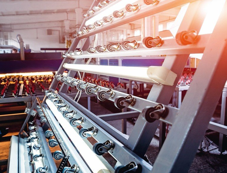 Conveyor_belt_for_production_a_window_pane._Industrial_equipment._Background