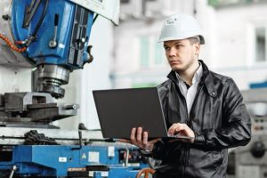 young_engineer_with_laptop_in_hands
