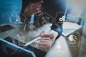 Machine_learning_technology_diagram_with_artificial_intelligence_(AI),neural_network,automation,data_mining_in_VR_screen.Website_designer_working_digital_tablet_dock_keyboard_and_computer_laptop_with_smart_phone.