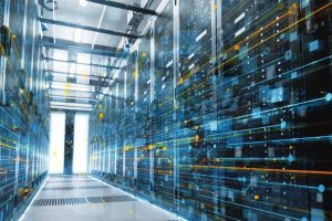 Shot_of_a_Working_Data_Center_With_Rows_of_Rack_Servers._People_Walk_and_Work_there,_they_are_Blurred_in_Motion._Long_Exposure_Shot.