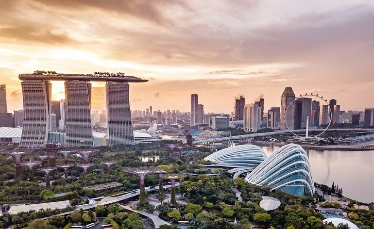 Aerial_drone_view_of_Singapore_city_skyline_at_sunset