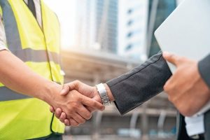 Engineers_shake_hands_with_businessman_after_success_day_and_celebrate_success.