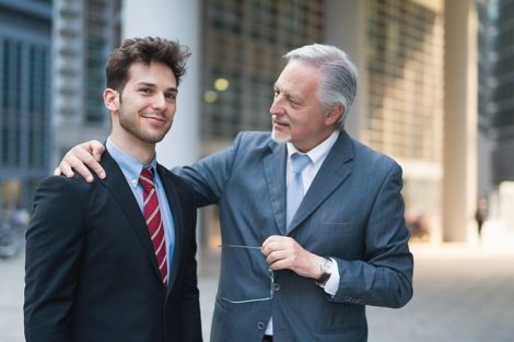 Portrait_of_a_confident_senior_businessman_talking_to_a_younger_colleague