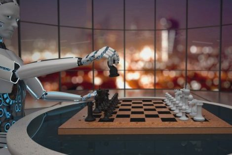 White_humanoid_robot_with_a_chessboard_on_the_table_sitting_in_the_modern_room._3d_illustration.