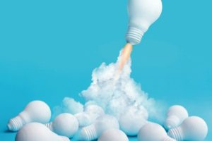Ideas_inspiration_concepts_with_rocket_lightbulb_flying_on_group_of_another_lightbulb.Business_start_up_or_goal_to_success._creativity_of_human