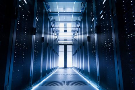 Shot_of_a_Corridor_in_Large_Working_Data_Center_Full_of_Rack_Servers_and_Supercomputers.