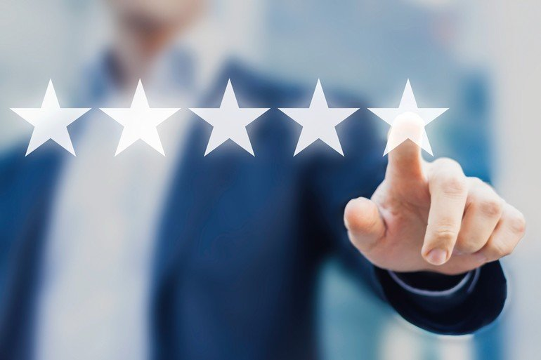 Five_stars_(5)_rating_with_a_businessman_touching_screen,_concept_about_positive_customer_feedback_and_review,_excellent_performance